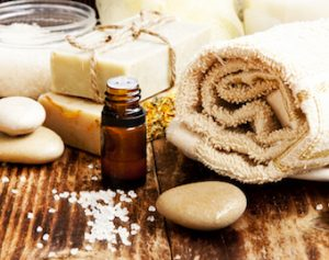 spa essentials such as rocks, soaps and essential oils